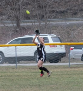Curwensville senior leftfielder Abby Johnson settles under a fly ball against Kane on Monday.  Kane out-dualed the Lady Tide 12-11 in nine innings.
