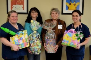 At the Easter basket presentation are (from left): Wendy Hardie, R.N., 5E/5F; Melony Lewis, Warnaco employee; Shirley Hoyne, Foundation for Life, and Danielle Peterman, R.N., 5E/5F. (Provided photo)