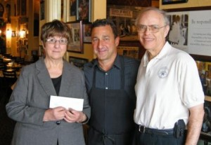 "Ed Tate (center) of Luigi's Ristorante presented a check for $312 to DuBois Area Historical Society President Ruth Gregori (left) and Second Vice President Tom Schott. The restaurant hosted a ""Dining for a Cause"" fundraiser for the society.  A basket auction and sale of society items raised the total for the day to $511. (Provided photo)"