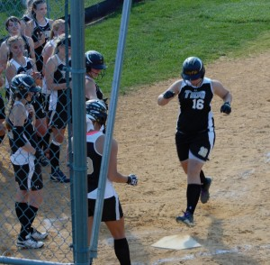 COMING HOME - Curwensville senior Tifany Carter gets a warm reception at home after a three-run homer in the sixth inning.  Curwensville defeated Moshannon Valley 11-2 to Claim the 2013 MVL Title (photo by Rusty McCracken)