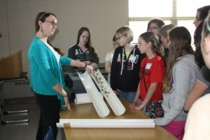 Kiya Riverman, a Penn State graduate student and volunteer instructor for Math Options, introduces seventh grade girls to glacial drift using models.  (Provided photo)