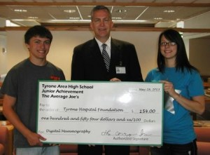 Pictured are representatives of the Average Joe's Junior Achievement group at Tyrone Area High School, as they present a $154 donation to the Tyrone Hospital Foundation for digital mammography. Pictured, from left to right, are Joe Gearhart, president of the Average Joe's, Stephen Gildea, chief executive officer at Tyrone Hospital and Morgan Taylor, vice president of Finance of the Average Joe's.  (Provided photo)