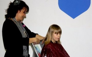 Six-year-old Adell Doty volunteered to have her hair cut by stylist Brenda McGarvey for the THON Hair Auction.  Doty also plans to donate the 10 inches of her hair that was cut to Locks of Love, to be made into wig for a cancer patient.  (Provided photo)