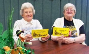 Clearfield Center for Active Living volunteers Eleanor Peters and E. Ann Reid are shown displaying the new booklet of the Spring Dining Out Club, which begins this month. (Provided photo)