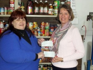 Pictured, from left to right, are Robin Clark, Clearfield Food Pantry worker and Connie Harris of the Clearfield Woman's Club. (Provided photo)