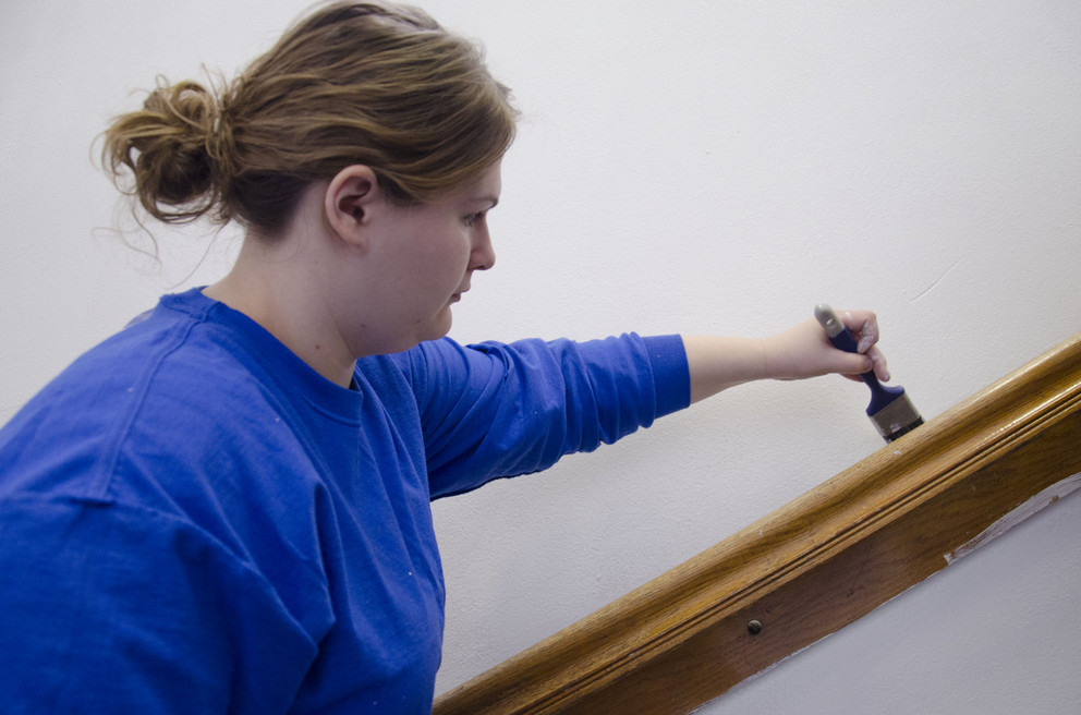 Lindsay Stoffer, a sophomore from Spring Mills, painted walls at the State College School District's 154 W. Nittany Ave. location March 1 as part of the State Day of Service. Penn State students from the Delta Theta Sigma and Alpha Zeta agricultural societies were sprucing up areas used by the district's Delta Program. (Provided photo)