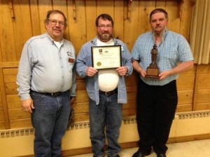 Greg Burkhouse, forest fire specialist supervisor, presents Edward Woods with his 20 years of service award. Also shown is Terry Smith, special investigator, with the Bronze Smokey Award. (Provided photo)