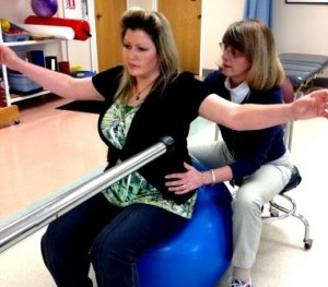 Vicky Nelson (left) works with HealthSouth Physical Therapist Sharon Rose to improve her balance and core strength.  Vicky transitioned from HealthSouth Nittany Valley's inpatient hospital to the outpatient clinic in Pleasant Gap to continue therapy after a non-traumatic brain injury.  (Provided photo)