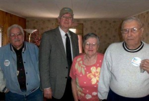 Pictured are Meals Driver Lou Mitchell, Commissioner John A. Sobel and Faye and John Wheeler. (Provided photo)