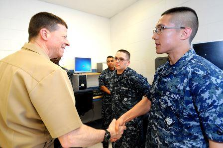 "Commander, Naval Education and Training Command (NETC), Rear Adm. Michael S. White, greeted Information Systems Technician (IT) ""A"" school students and answered questions during his first official visit to CID. CID is the Navy's learning center that leads, manages and delivers Navy and joint forces training in information operations, information warfare, information technology, cryptology and intelligence. (U.S. Navy photo by Gary Nichols/Released)"