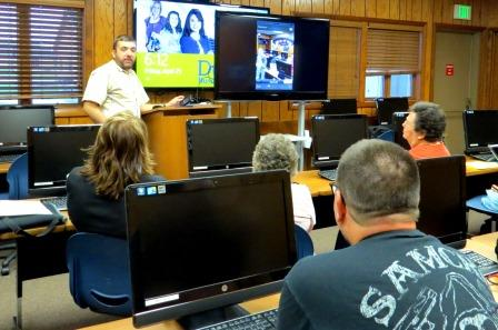 Workshop students observe, as Andy Park, workshop instructor demonstrates camera usage on the iPad. (Provided photo)