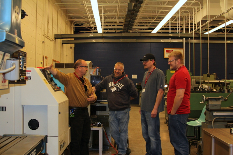 CNC Instructor Bruce Smith with participants Chris Hetrick and Tony Polaski, employees of Keystone Powder Metal Company and Brian Licatovich, employee of Symmco Inc. (Provided photo)