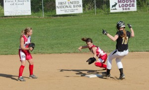 Senior designated player Kealy Wassil pulls into second after one of her three hits against Redbank Valley in a 13-3 District IX Class AA quarterfinal win.  Wassil scampered into second when her hit to center was misplayed.  Bullgog second baseman Mackenzie Pence tries to apply the late tag while teammate Kimberly Shick backs up the play.  (photo by Rusty McCracken)