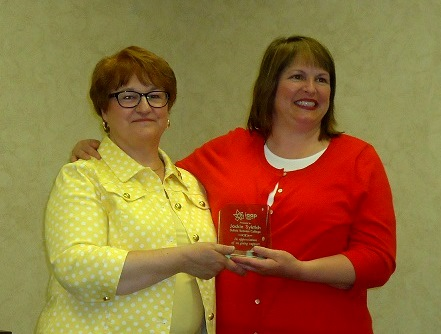 Carol Lundgren, CAP-OM, president of Clear-Penn chapter presented a special award to Jackie Syktich, president of DuBois Business College. (Provided photo)