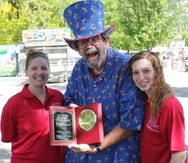 Children's Miracle Network Coordinator Vanessa Houser (left) presents Dennie Huber with the Dillman Award with Children's Miracle Network volunteer and intern Melanie Swartz (right). (Provided photo)