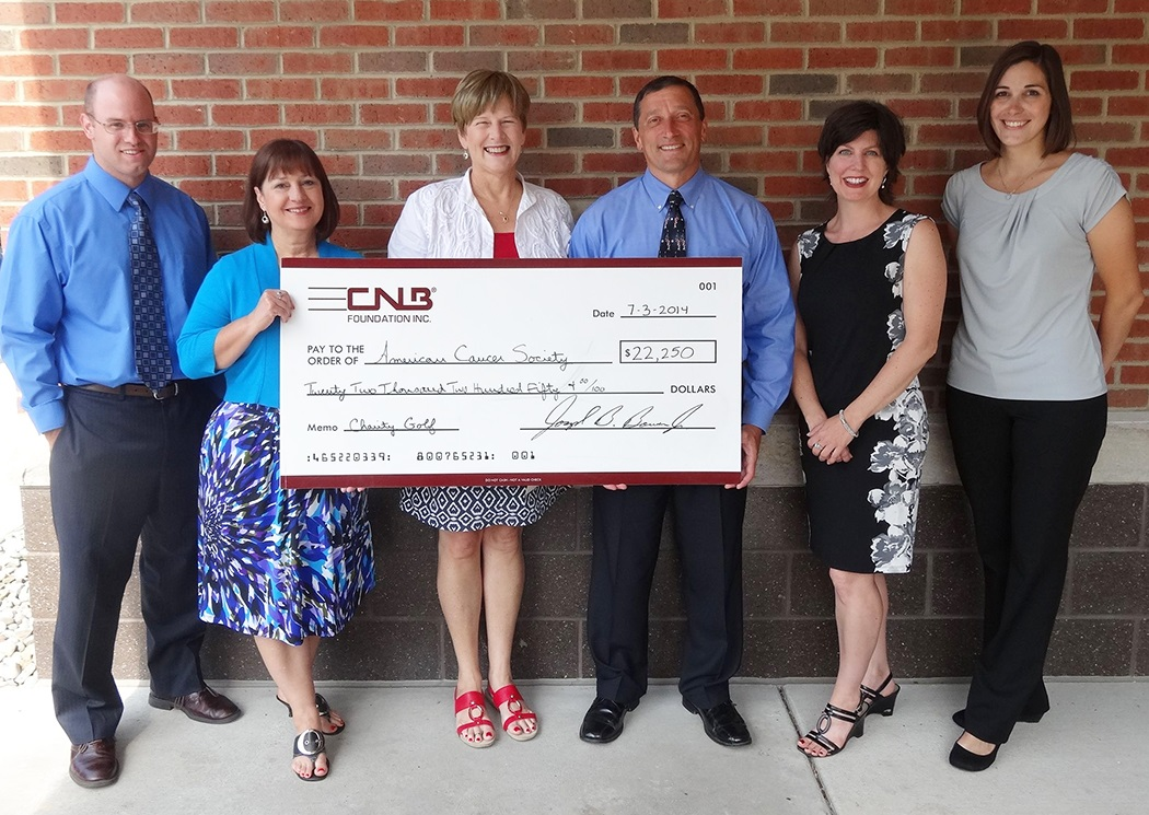 Pictured, from left to right, are: Greg Dixon and Carolyn Smeal, CNB Charity Golf Outing committee members; Janet Ulmer, ACS East Central Division director of health initiatives; Joe Bower, CNB president and chief executive officer; Eileen Ryan and Amy Potter, CNB Charity Golf Outing committee members. (Provided photo)