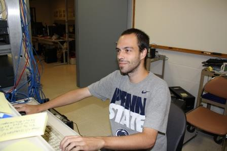 IST Program graduate Cody Weible works on a server in the Penn State DuBois IST Lab.  He will start his position with Amazon.com in August. (Provided photo)