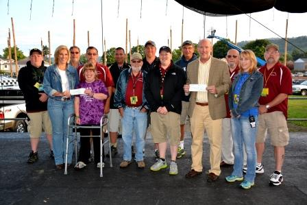 Pictured, in the back from left, are Greg Hallstrom Jr; Allen Roseberry; Steve Livergood; George Proud; Steve Flanagan; Jeff Fink; David Hallstrom; and Greg Hallstrom. In the front, from left, are Michelle Homman, assistant manager for Special Olympics of Clearfield County; Brooke Haney; Bill Hoover; David Franson; Kevin McMillen, chairperson for Clearfield County Charitable Foundation; and Brenda Morgan. (Provided photo)