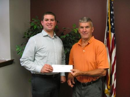 Chris Renaud of the CRC is pictured accepting the check from Bob Knepp, owner of the Ritz Theater. (Provided photo)