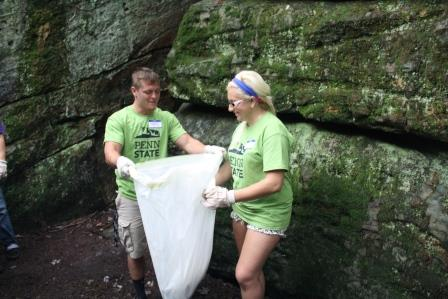 Students Mathew Humes and Nicole Harshbarger bag litter as they clean up Bilger's Rocks, a massive 320 million year old sand stone formation near Grampian. (Provided photo)