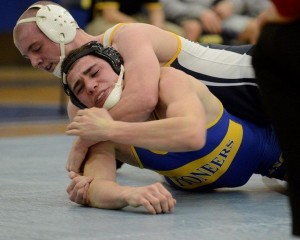 Nolan Barger controls Alfred State's George VanValen in 8-2 win. (Photo courtesy of Lycoming College Athletic Department)