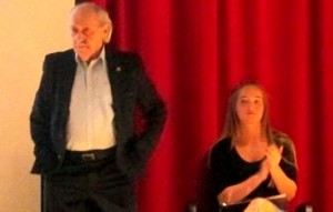 Auschwitz Concentration Camp survivor David Tuck stands during a recent assembly at the Clearfield Area Junior-Senior High School. Seated is Erica Hanes, whose interview with Tuck for her ninth-grade research project about the Holocaust led to his visit to the school.  (Photo by Anna Brower)