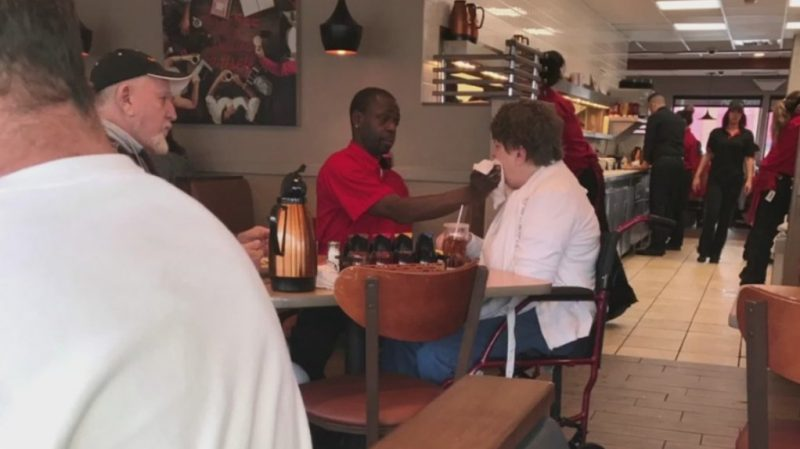 IHOP waiter offered job after photo shows him helping disabled customer eat