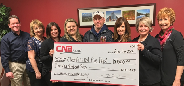 Worley Helps CNB Employees Stranded on I-80; Bank Shows Appreciation with Donation